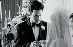 Elvis and Priscilla's wedding c.1967. Exchanging rings