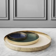 Copenhagen studio GamFratesi has created a collection of spun-brass trays with leather surfaces for Swedish metal company Skultuna.