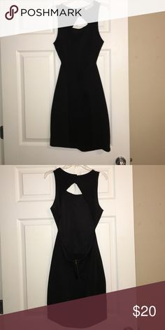 Dress The perfect little black dress, beautiful back opening. No size on tag but fits a M Dresses Mini