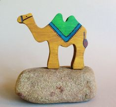 Hey, I found this really awesome Etsy listing at https://www.etsy.com/listing/160698550/wooden-camel-toy-waldorf-natural-silk