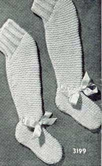 free vintage knits. Knee-high booties. Bet a baby would have a tough time taking THESE off.