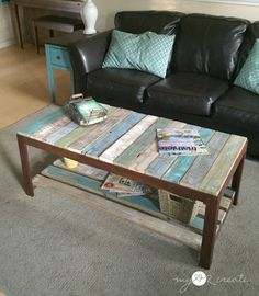 Give a dated or broken glass top coffee table a new look and added storage -- for free -- using pallet wood and some paint or stain. Love these colors!