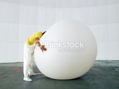 Stock Photo : Man with head buried in huge weather balloon