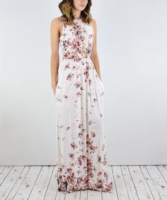 Take a look at this éloges Ivory & Purple Floral Maxi Dress today!