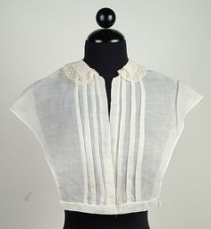 Chemisette, American, ca. 1860. Linen with tucked front, no closures noted, on a band. Shown with whitework collar edged with lace. MET