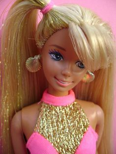 OMG i used to have this Barbie when i was little ... I loved her top!!