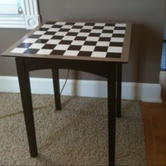 A $12 thrift store table, and a little paint and time resulted in this chess/ checkerboard table for the deck:)