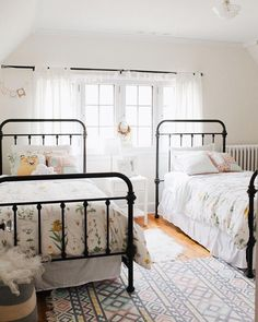 Black bed frame kids bedroom with two beds and wrought iron bed frames Room, Wrought Iron Bed Frames, Farm House Living Room, Shared Girls Bedroom, Iron Bed Frame, Bedroom Design, Home Decor, Bed, Wrought Iron Beds