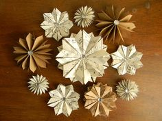 10 Paper Star Ornaments Vintage Book Pages Kraft Paper Handcut and Folded Rhinestone Center //MADE TO ORDER//. $30.00, via Etsy.