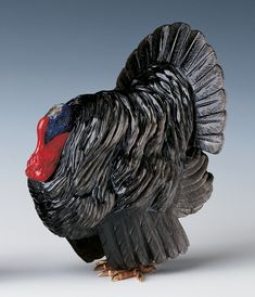 Fabergé model Norfolk Black turkey. The black obsidian perfectly captures the full body and feathers of the bird and is combined with the purpurine, lapis lazuli and rose diamonds to represent the head of the bird. Commissioned by King Edward VII, 1907 (the Sandringham Commission); bought by the Prince of Wales (later King George V) from Fabergé's London branch, 1909, (£55); presented to Queen Alexandra on her birthday, 1 December 1909.