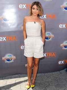 Casual chic: Sarah Hyland showed off her beautifully toned legs in white romper shorts as ...