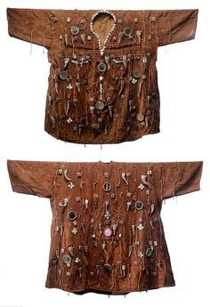 "Africa | Hunter's shirt (front and back) from the Bamana/Dogon people of Mali. These garments, called shirts, jackets or tunics were worn by Dogon or Bamana men for protection in the forest, from both wild animals and dangerous spirits. They are often embellished with small objects, animal horns, mirrors, jewelry, and leather pouches, that provide the ""spiritual armor"" necessary to protect the hunter from both real and spirit forces. 
