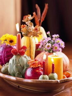 Autumn centerpiece from the Farmer's Market....veggie candle holders...