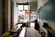This cafeteria style cafe has a very casual look with the wood tables and chalkboard!