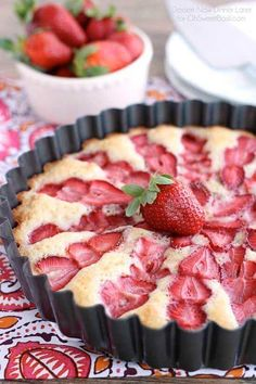 Strawberry Cake - this from scratch cake is cooked with layered strawberries for a stunning, lightly sweet cake that is best served with a side of sweetened coconut whipped cream.
