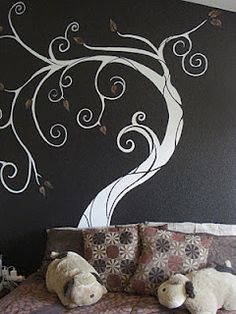 We decided to paint a funky tree on the bedroom wall. We painted the wall .
