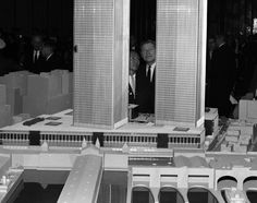 "Though the idea for the New York City landmark was first proposed in 1946, it was Governor Nelson Rockefeller, who looks at a model of the World Trade Center in 1964 with its architect, Minoru Yamasaki, that helped make the dream a reality. Yamasaki was the one who came up with the plan to have two towers, later known simply as the ""Twin Towers."""