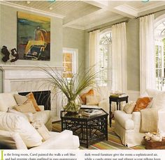 calm living room blue green walls white drapes slipcovered chair orange accents black coffee table marble fireplace orange green gray striped rug green blue orange living room love color of curtains and walls and feel of room Glam Living Room, Cottage Living Rooms, Coastal Living Rooms, Home And Living, Living Spaces, Glam Room, Small Living, Salons Cottage, Soft Surroundings