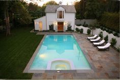 little white house and pool. I like how the yard is half stone half grass