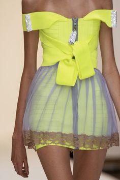 Christopher Kane . Women's fashion . Neon Yellow . Grey . Sheer pleated over skirt . Waist tie
