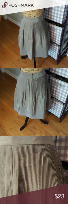 "Banana Republic Silver Pleated Full Skirt In excellent condition. Banana Republic skirt. Pleated detail at top with full skirt at bottom. Cotton silk blend. Completely lined. Side zipper. Measurements are length 23"", waist 30"". 2 Banana Republic Skirts A-Line or Full"