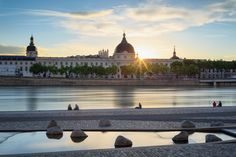 Grand Hôtel-Dieu - The people of Lyon like to enjoy a summer evening at the Rhone river. With this lovely sunset view at the renovated Grand Hôtel-Dieu, who can blame them?