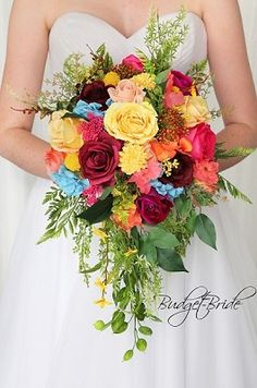 Custom Made Wedding flowers to match Davids Bridal colors. Design the perfect brides bouquet for yourself, your groom and your bridesmaids! Coral Wedding Flowers, Bridal Bouquet Blue, Cascading Wedding Bouquets, Bridesmaid Flowers, Bride Bouquets, Bridal Flowers, Flower Bouquet Wedding, Bouquet Flowers, Wedding Colors