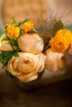 roses, ranunculus, and explosion gass