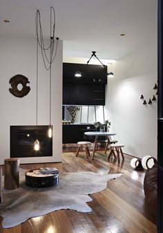 Everything about this room is me!  Love the carpet, hardwood floors, industrial light, black and white.