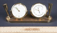 VINTAGE BRASS SWIVEL PHINNEY-WALKER ALARM CLOCK AND BAROMETER WITH PEN HOLDERS ON EACH SIDE, MEASURES 8 IN. W.
