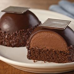 Chocolate Bombe Cakes have a layer of chocolate caramel mousse on chocolate devil's food and covered with dark chocolate ganache. My dream dessert! Baking Recipes, Cake Recipes, Dessert Recipes, Brownie Recipes, Recipes Dinner, Dinner Ideas, Mini Desserts, Just Desserts, Elegant Desserts