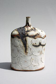 2009-saggar-fired-bottle-with-scored-porcelain-overlay-23cm-x-15cm.jpg - Jane Wheeler