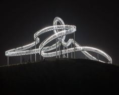 The 21-metre-high sculptural walkway is named Tiger and Turtle – Magic Mountain and is positioned upon a hilltop in Duisburg, Germany.