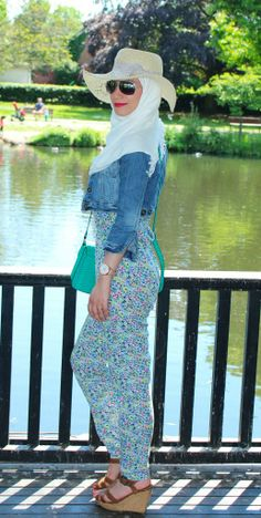 A summer look for hijabis: floral #jumpsuit white scarf, straw hat and pink lipstick. For more www.hayfaglam.com please support me by liking my page www.facebook.com/hayfaglam #summerfashion #fashion #hijab #hijabi #makeup #pinklipstick