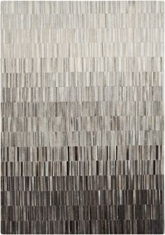 Hand crafted hair on hide rug with an ombre effect from Surya. (OUT-1010)