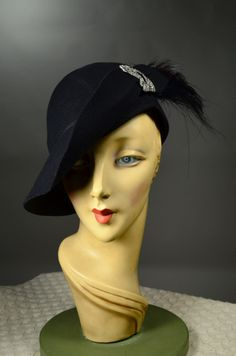 ART DECO PIECED FELT 1930'S VINTAGE WOMEN'S HELMET CLOCHE HAT - EGRET PLUME - RHINESTONE CLIP. SOLD at rpvintage.com.