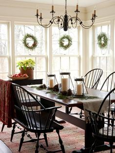 love the love seat chair at the table and the simple christmas decorations - I want this as my kichen nook!