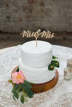 Brides: Mrs. and Mrs. Wooden Calligraphy Monogram. This summer, the Supreme Court ruled that gay marriage bans are unconstitutional and the cherry on top of all those sweet upcoming nuptials is a cake topper that celebrates #loveislove sitting pretty on the tiered confections.