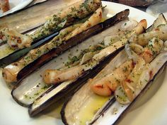 Grilled Razor Clams  by Sifu Renka  Razor clams are difficult to find ... but if you do happen to find them, this is a really good recipe