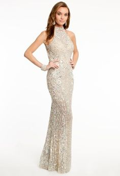 Get ready to light up the night with this long and elegant dress from Camille La Vie. This dress has it all, making it the dress people will always remember at prom or homecoming. The main feature of the dress is the carefully beaded, small and large rhinestones that will sparkle away all throughout the night. It also features a halter neckline and sheath skirt with chapel train that adds a little elegance and class to this eye-catching party dress. Make this style even more memorable by ...
