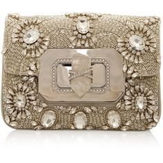 We're slightly obssessed with vintage-looking handbags, like this small clutch from Marchesa.