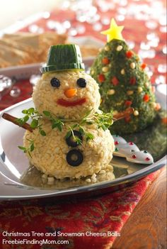 Christmas Tree and Snowman Cheese Balls - No boring cheese ball here. Bring these little cuties to your next holiday gathering and they'll be the hit of the party. Pinned over 3,000 times.
