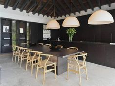 Lavish Villa Teman on St Barth's: now that's a long table. love this black dining room with the wishbone chairs