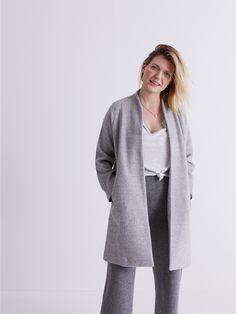 madewell stanza herringbone coat and anthem split-neck tee + wide-leg sweater pants worn by madewell merch master beth.