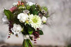 Bridal bouquet of 'Margaret Merril' roses, zinnia, berries and grasses. by…