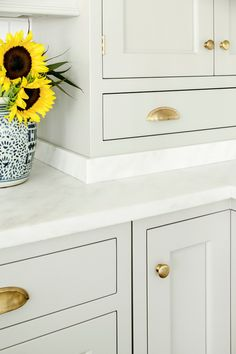 Gray Cabinets and Imperial Danby Marble Countertops: It has all the sparkle and movement of the more commonly used Calcatta, but Danby's veining is more blurred and restful to the eye.