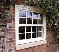 A heritage classic, white, uPVC Georgian style sliding sash windows; preserving traditionalism to any given home!