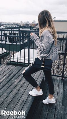 Blogger Sonia France spends her days in comfortable style featuring white Classic Leather sneakers.