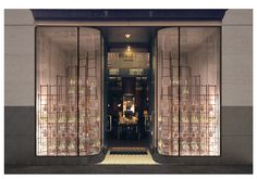 Penhaligon's by Al-Jawad Pike, Regent Street London during September 2014.  Part of RIBA Regent Street Windows Project, which launches in September 2014 as part of the London Design Festival.  A labyrinthine construction of blown glassware, held within a three-dimensional lattice of copper pipe.