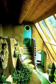 an amazing water feature in an earthship-style underground home